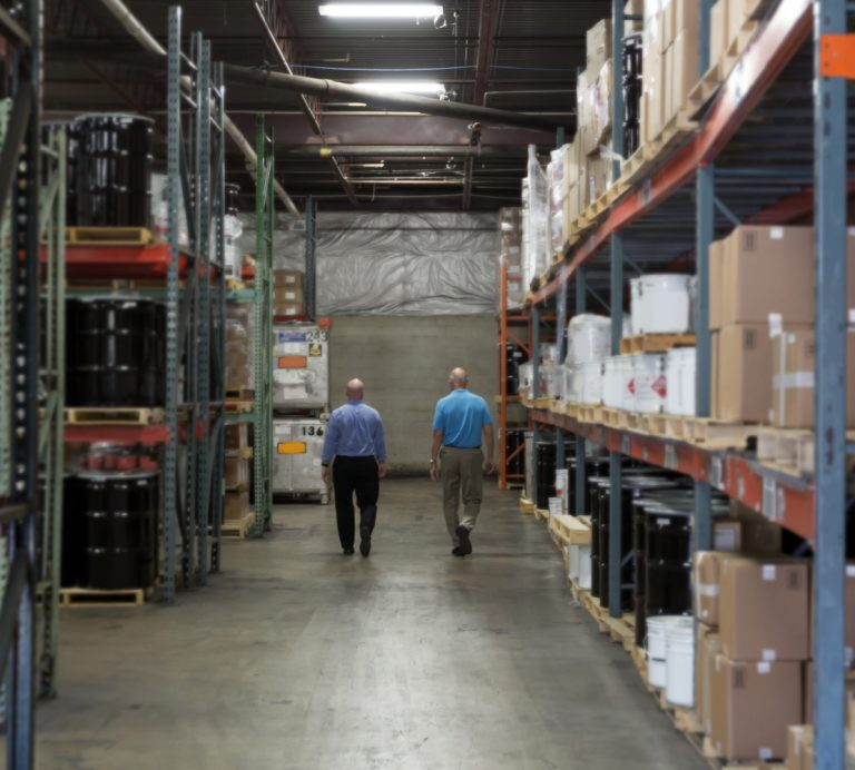 choice adhesives workers walking in warehouse