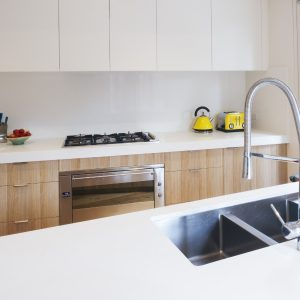 bright kitchen with white countertops choice adhesives