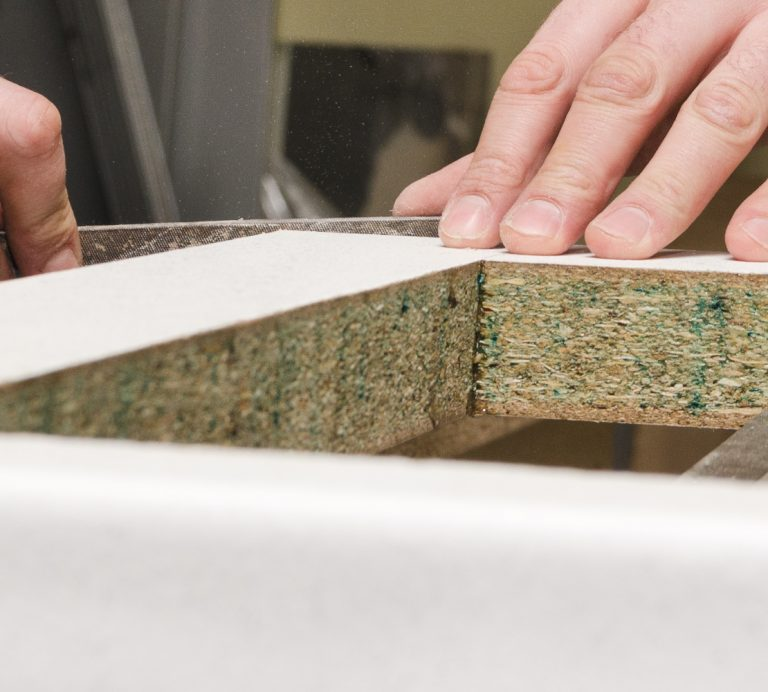 employee crafting countertop choice adhesives