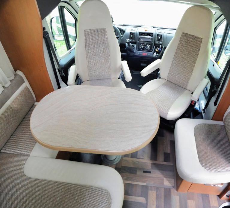 RV interior with swivel seats choice adhesives